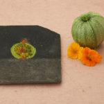 mosaïque sur objets-dessosu-de-plat courgette